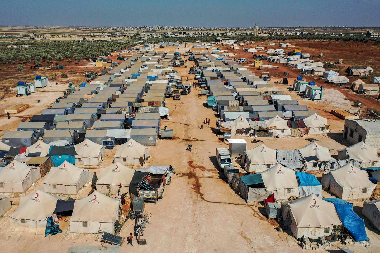 This picture taken on July 9, 2020 shows an aerial view of tents at the Azraq camp for displaced Syrians near the town of Maaret Misrin in Syria's northwestern Idlib province, sheltering several hundred families displaced by conflict from the northern Hama and southern and eastern Idlib countrysides.  / AFP / Omar HAJ KADOUR