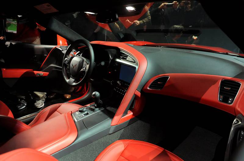 The interior of the 2014 Chevrolet Corvette Stingray is seen after being unveiled ahead of the 2013 North American International Auto Show (NAIAS) in Detroit, Michigan, U.S., on Sunday, Jan. 13, 2013. The new model, set to reach dealers in this year's third quarter, is part of the push to breathe new life into the Chevy brand, which accounted for 71 percent of GM's 2012 U.S. sales. Photographer: Daniel Acker/Bloomberg *** Local Caption ***  1148278.jpg