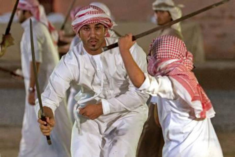 Fujariah, November 5, 2010 - Young men display their swordsmanship during a demonstartion prior to the start of the Al Saif Traditional Sword Competition in Fujariah City, Fujariah November 5, 2010. (Jeff Topping/The National)