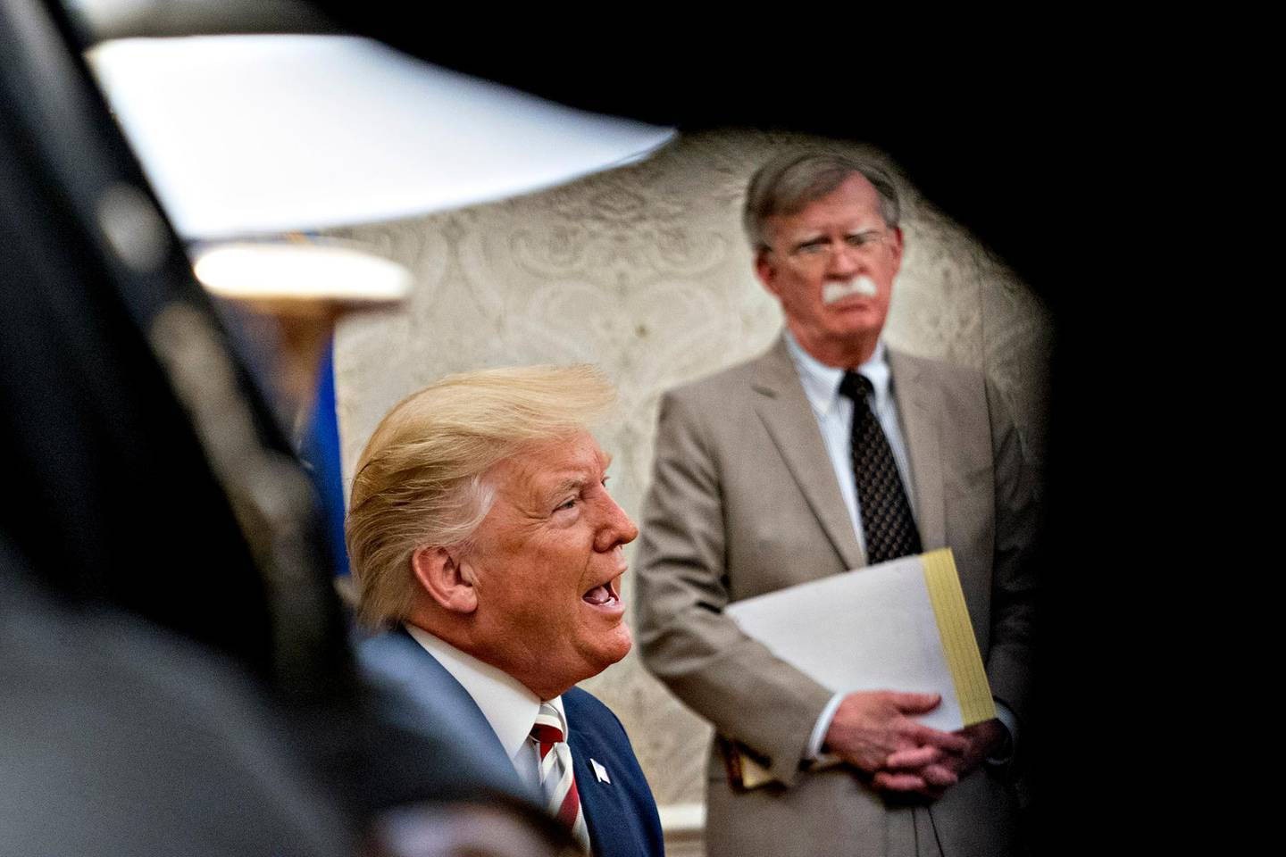 epa08493524 (FILE) - US President Donald Trump speaks as John Bolton, national security advisor, listens during his meeting with Klaus Iohannis, Romania's president, not pictured, in the Oval Office of the White House in Washington, DC, USA, 20 August 2019 (reissued 18 June 2020). According to media reports, the US government wants to prevent publication of a book by former National Security advisor Bolton, arguing that national security was at risk.  EPA/Andrew Harrer / POOL *** Local Caption *** 55406002