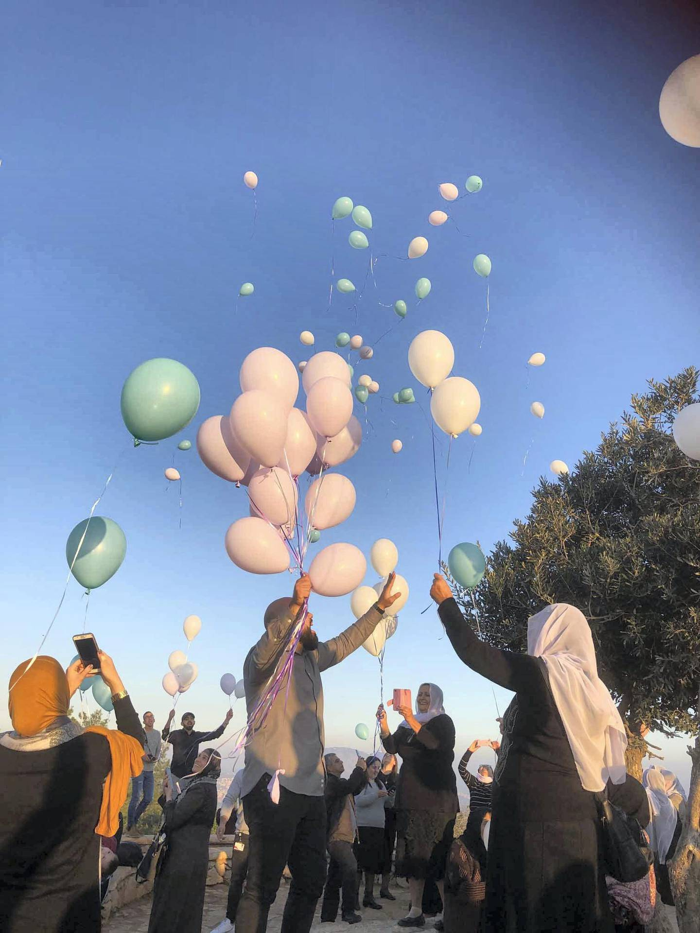 Many Muslims, Christians, Jews and Druze travelled up to Mount Precipice to release hundreds of balloons for peace after breaking bread together in Nazareth last week. Courtesy Rashmee Roshan Lall