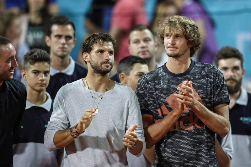 Bulgaria's Grigor Dimitov and Germany's Alexander Zverev are seen during the trophy ceremony during Adria Tour at Novak Tennis Centre in Belgrade, Serbia, June 14, 2020. Picture taken June 14, 2020. REUTERS/Marko Djurica