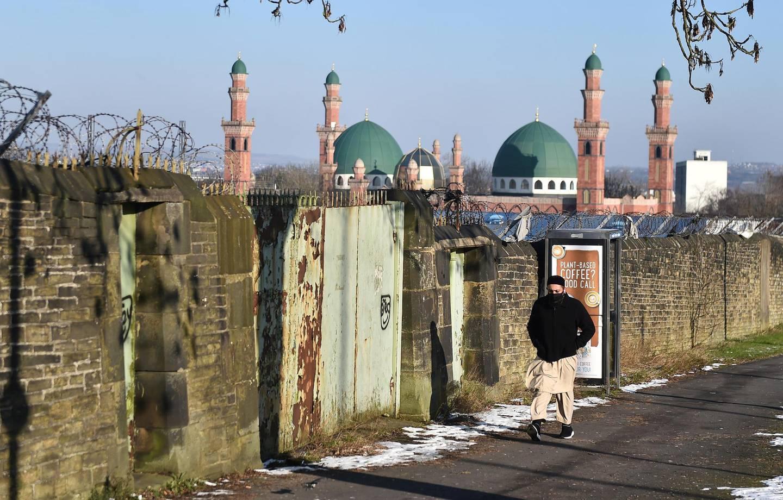 BRADFORD, ENGLAND - FEBRUARY 12: A man walks past Al-Jamia Suffa-Tul-Islam Grand Mosque on February 12, 2021 in Bradford, England. (Photo by Nathan Stirk/Getty Images)