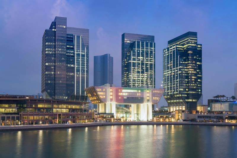FH1NBM Evening view of new financial and business district called Abu Dhabi Global Market square (ABGM) on Al Maryah Island Abu Dhabi. Alamy