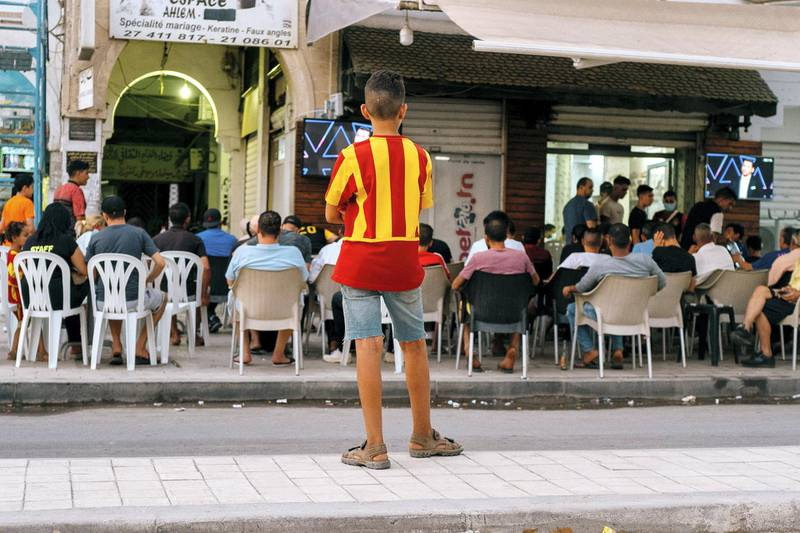 By the time the match is set to begin, so many people in Bab Souika are wearing the team's yellow and red stripes that the neighborhood looks like a Where's Wally spread. Erin Clare Brown/ The National