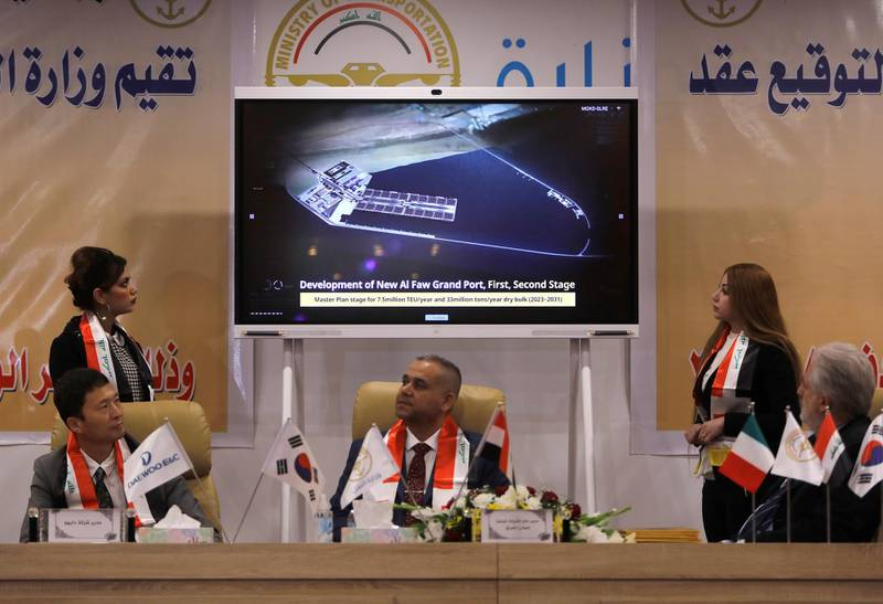 An image is displayed on a screen as Iraq's director general at the General Company for Ports, Farhan al-Fartousi, signs a contract with South Korea?s Daewoo Engineering & Construction, to construct the Grand Faw port, in Baghdad, Iraq December 30, 2020. REUTERS/Khalid al-Mousily