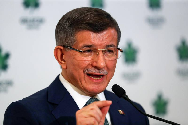 """Former Turkish prime minister and """"Future Party"""" chairman Ahmet Davutoglu (L) gives a press conference after his party's meeting in Ankara on December 19, 2019. Davutoglu, who served as prime minister between 2014 to 2016 and chairman of Erdogan's ruling party, formally presented the Future Party (""""Gelecek Partisi"""" in Turkish) at a ceremony in Ankara. / AFP / Adem ALTAN"""