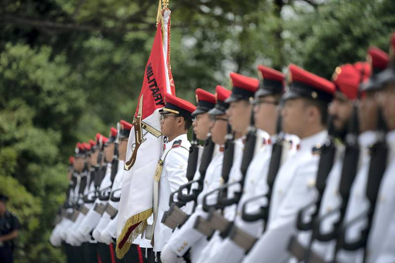 SINGAPORE, SINGAPORE - February 28, 2019: Armed forces honour guard participate in an official reception for HH Sheikh Mohamed bin Zayed Al Nahyan, Crown Prince of Abu Dhabi and Deputy Supreme Commander of the UAE Armed Forces (not shown), at the Istana presidential palace. ( Ryan Carter / Ministry of Presidential Affairs )