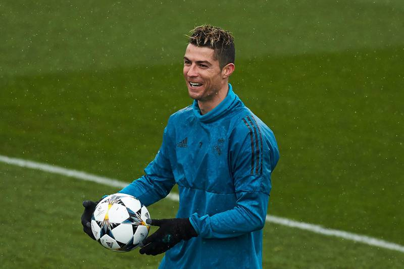 MADRID, SPAIN - APRIL 10: Cristiano Ronaldo of Real Madrid CF jokes with his team mates during a training session ahead of their UEFA Champions LEague quarter final second leg match against Juventus at Valdebebas training ground on April 10, 2018 in Madrid, Spain. (Photo by Gonzalo Arroyo Moreno/Getty Images)