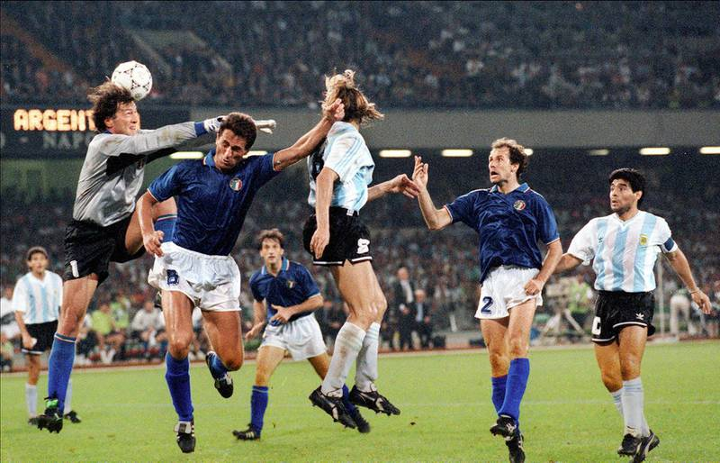 Argentinian forward Claudio Caniggia (C) scores on a header as Italian goalkeeper Walter Zenga comes up short (R) 03 July 1990 in Naples during the World Cup semifinal soccer match between the two countries. Argentina advanced to the final 4-3 on penalty kicks at the end of extra time (1-1 at the end of regulation time). At right, defender Franco Baresi and midfielder Diego Maradona.  AFP PHOTO / AFP PHOTO / STAFF