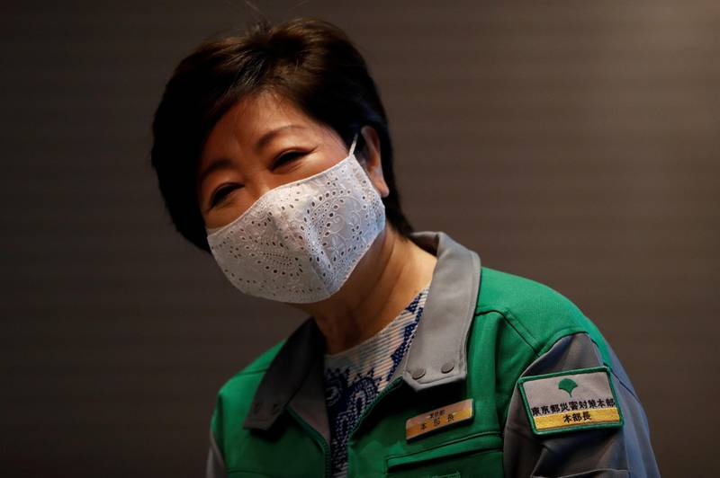 FILE PHOTO: Tokyo Governor Yuriko Koike wears a protective face mask during a press preview of a hotel of APA Group that has been designated to accommodate asymptomatic people and those with light symptoms of the coronavirus disease (COVID-19) to free up hospital beds and alleviate work by nurses and staff members, in Tokyo, Japan May 1, 2020. REUTERS/Issei Kato/File Photo