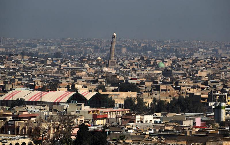 A general view shows the leaning minaret of the Great Mosque of al-Nuri in Mosul, on March 10, 2017, as Iraqi forces shell enemy positions during an offensive to retake the western parts of the city from the jihadists. (Photo by AHMAD AL-RUBAYE / AFP)