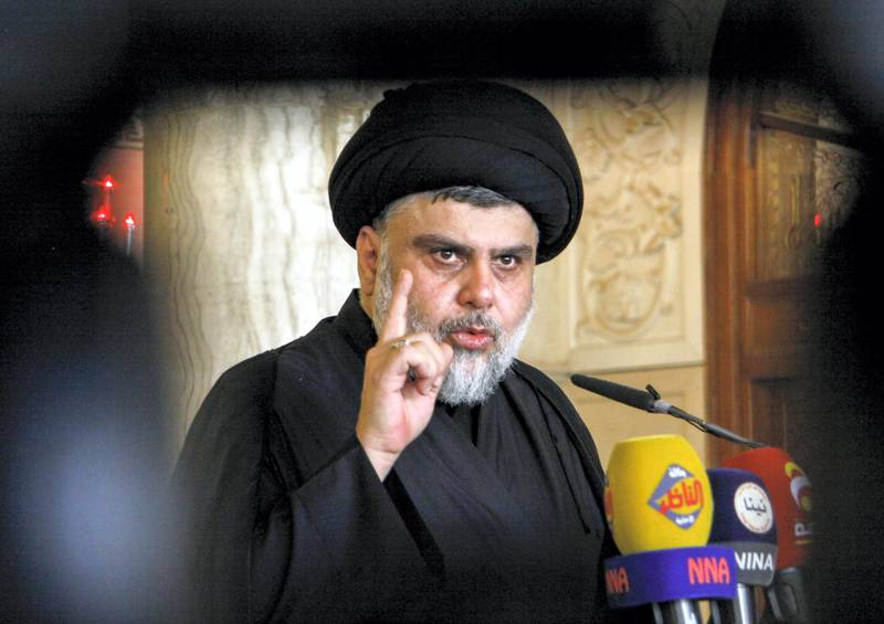 Iraqi Shiite leader and cleric Moqtada al-Sadr delivers a speech to his supporters following Friday prayers at the grand mosque of Kufa in the central Iraqi shrine city, some 160 kilometres south of the capital Baghdad, on September 21, 2018. (Photo by Haidar HAMDANI / AFP)