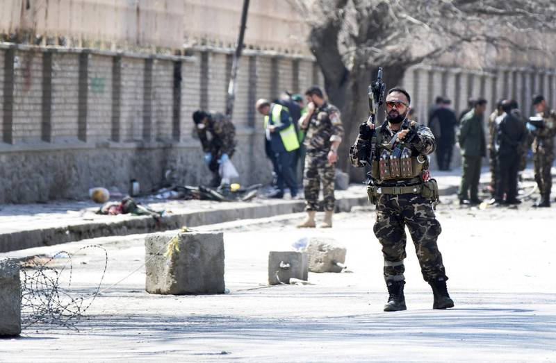 epaselect epa06617171 Afghan security officials inspect the scene of a suicide bomb blast that targeted a shrine visited by Shi'ite Muslims as the country observes the Nowruz Persian New Year, in Kabul, Afghanistan, 21 March 2018. According to media reports at least 26 people were killed in the incident. Kabul authorities overhauled the security plan of the city after the attack, establishing a new system to prevent large-scale attacks.  EPA/HEDAYATULLAH AMID