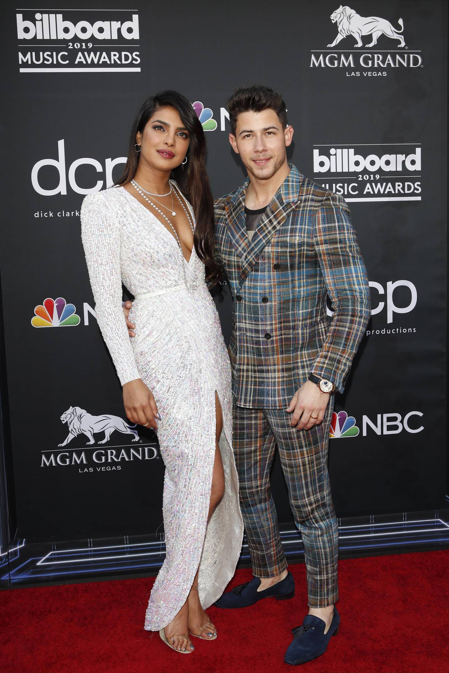 epa07541613 Indian singer Priyanka Chopra (L) and US singer Nick Jonas (R) arrive for the 2019 Billboard Music Awards at the MGM Grand Garden Arena in Las Vegas, Nevada, USA, 01 May 2019. The Billboard Music Awards finalists are based on US year-end chart performance, sales, number of downloads and total airplay.  EPA/NINA PROMMER