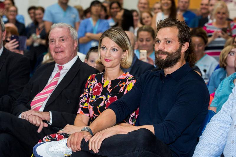 Northern Irish actor Jamie Dornan (right) with his sister Jessica Dornan Lynas and father Dr Jim Dornan, during the Pancreatic Cancer charity NIPanC launch at the Mater Hospital in Belfast. (Photo by Liam McBurney/PA Images via Getty Images)
