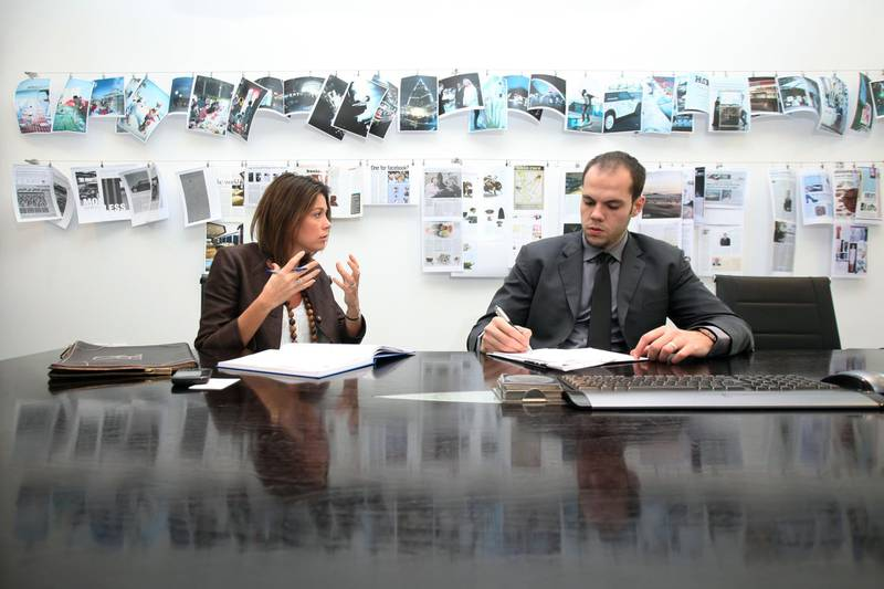 DUBAI, UNITED ARAB EMIRATES - DECEMBER 8:  Camilla d'Abo (L), managing partner, and Jamal al Mawed (R), account manager, d'pr, discuss a work project at their offices in Dubai on December 8, 2010.  (Randi Sokoloff for The National)  For Business Sector story by Ben Flanagan