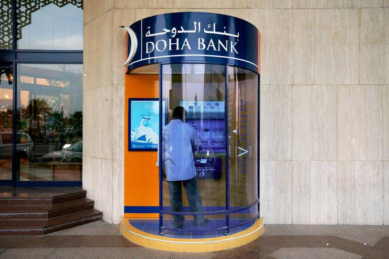 DOHA, QATAR - February 19, 2009: A man uses the atm machine or bank machine at a Doha Bank branch in Doha, Qatar.( Ryan Carter / The National )*** stock, bank, *** Local Caption ***  RC031-DohaBanking.JPGRC031-DohaBanking.JPG