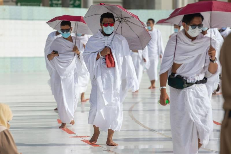 Pilgrims perform Tawaf Al-Ifadah at the holy mosque in Makkah after stoning the Jamarat. Saudi Ministry of Media