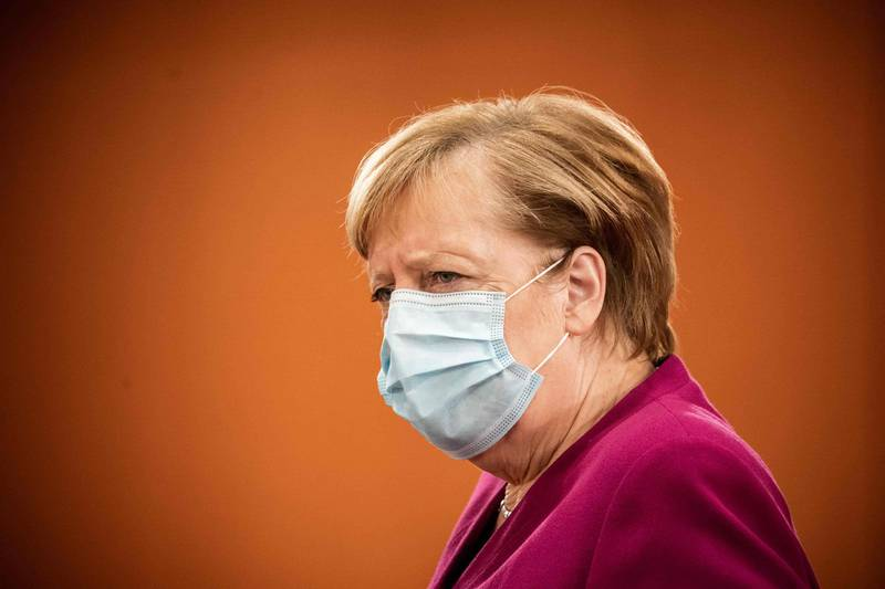 German Chancellor Angela Merkel wearing a face mask frowns as she arrives to attend the weekly cabinet meeting of the German government at the Chancellery in Berlin, on October 14, 2020.  / AFP / POOL / Michael Kappeler