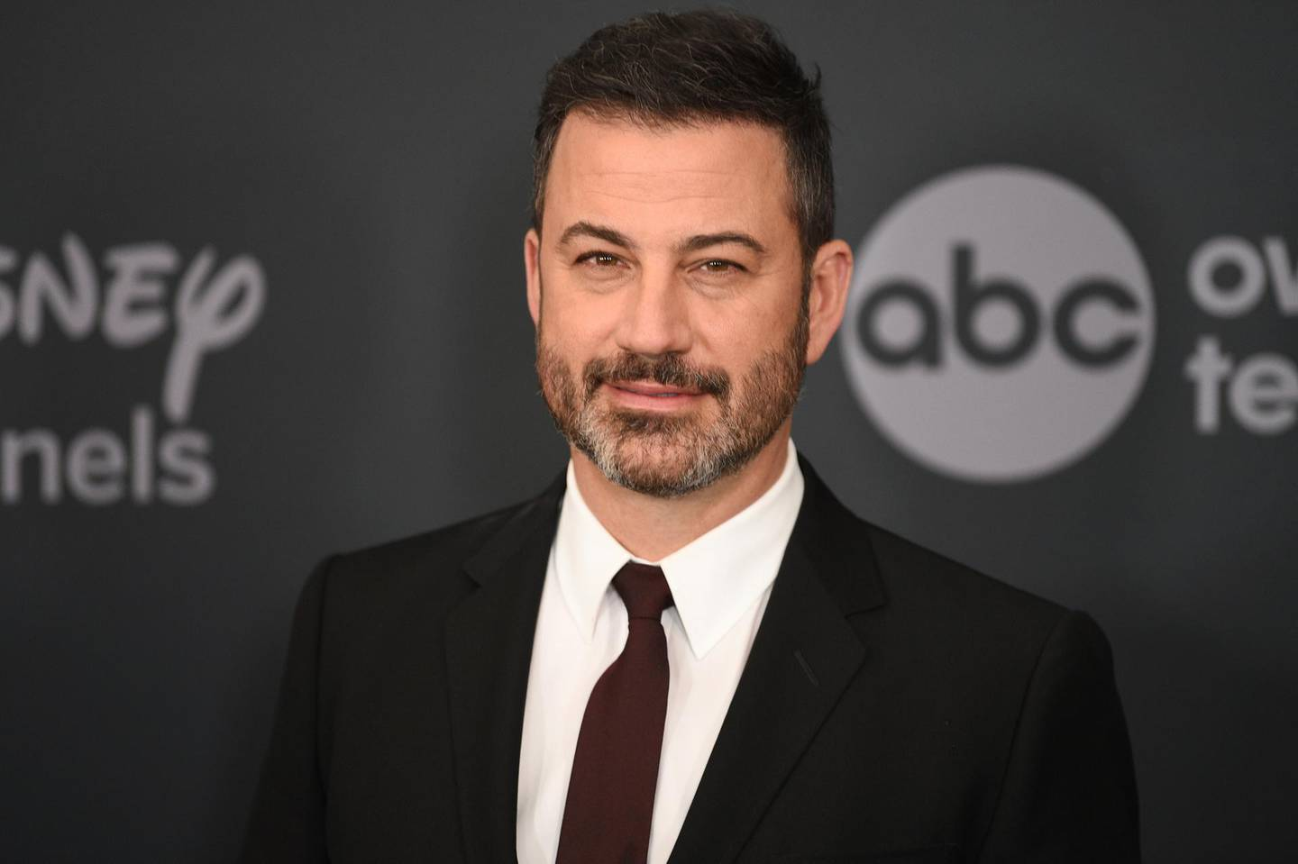 """FILE - This May 14, 2019 file photo shows Jimmy Kimmel at the Walt Disney Television 2019 upfront in New York. Kimmel will host a prime-time edition of """"Who Wants To Be A Millionaire"""" with stars as the contestants and winnings earmarked for their causes of choice. It will debut this spring on ABC. (Photo by Evan Agostini/Invision/AP, File)"""