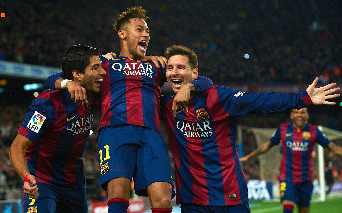 FILE - In this Sunday, Jan. 11, 2015 file photo, FC Barcelona's Lionel Messi, right, Neymar, center, and Luis Suarez, celebrate after scoring against Atletico Madrid during a Spanish La Liga soccer match at the Camp Nou stadium in Barcelona, Spain. Barcelona said, Wednesday, Aug. 2, 2017, Neymar's 222 million euro ($262 million) release clause must be paid in full if the Brazil striker wants to leave. (AP Photo/Siu Wu, File)