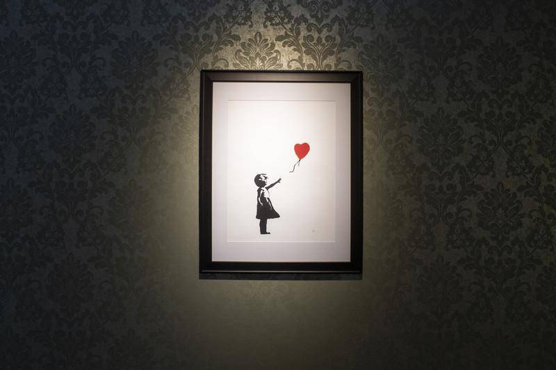 epa07273894 An artwork by anonymous British street artist Banksy is on display during the opening of the exhibition 'PUNK: Raw Power - The Revolt Against Innocent' in Zurich, Switzerland, 10 January 2019.  EPA-EFE/ENNIO LEANZA