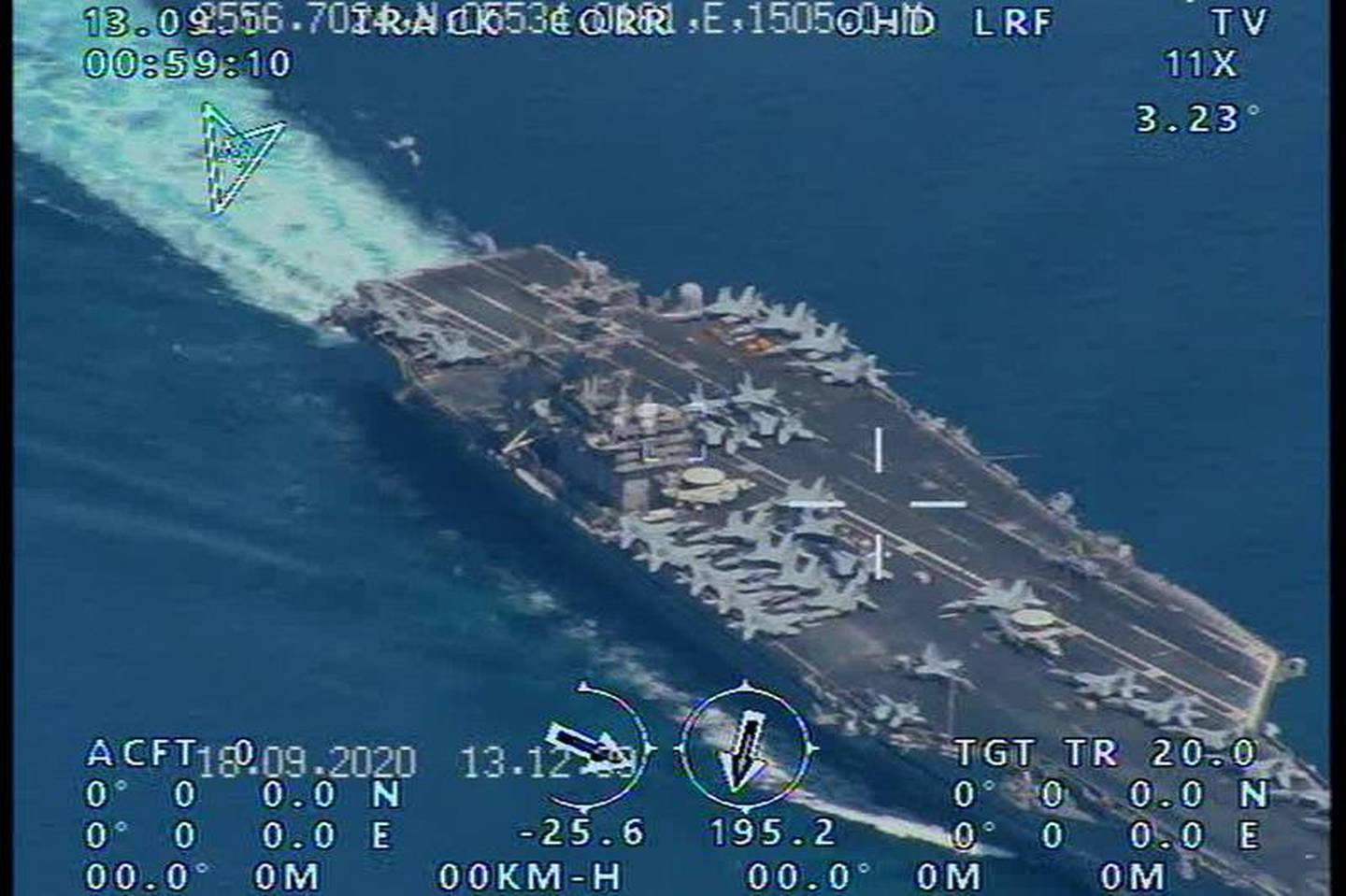 epa08690749 A handout picture released by the official website of Iranian Revolutionary Guard (IRGC) on 23 September 2020, reportedly shows the USS Nimitz Aircraft carrier prior to entering the Strait of Hormuz and Persian Gulf, which was taken by an Iranian IRGC drone. Media reported that Iranian IRGC has managed to fly a surveillance drone over the USS Nimitz aircraft carrier which last week transited from the Strait of Hormuz.  EPA/HANDOUT  HANDOUT EDITORIAL USE ONLY/NO SALES