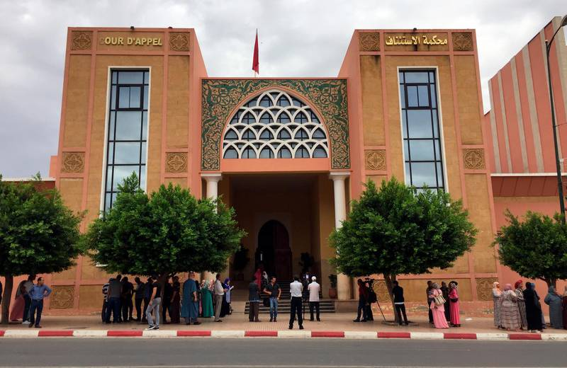 The courthouse of Beni Mellal, Morocco is pictured, Thursday, Sept. 6, 2018. Family members of a dozen young men suspected in the gang-rape, forcible tattooing and torture of a 17-year-old Moroccan girl, Khadija, allegedly held captive for two months made a ruckus outside the courtroom where an investigative judge held his first hearing in the case. (AP Photo/Nadine Achoui-Lesage)