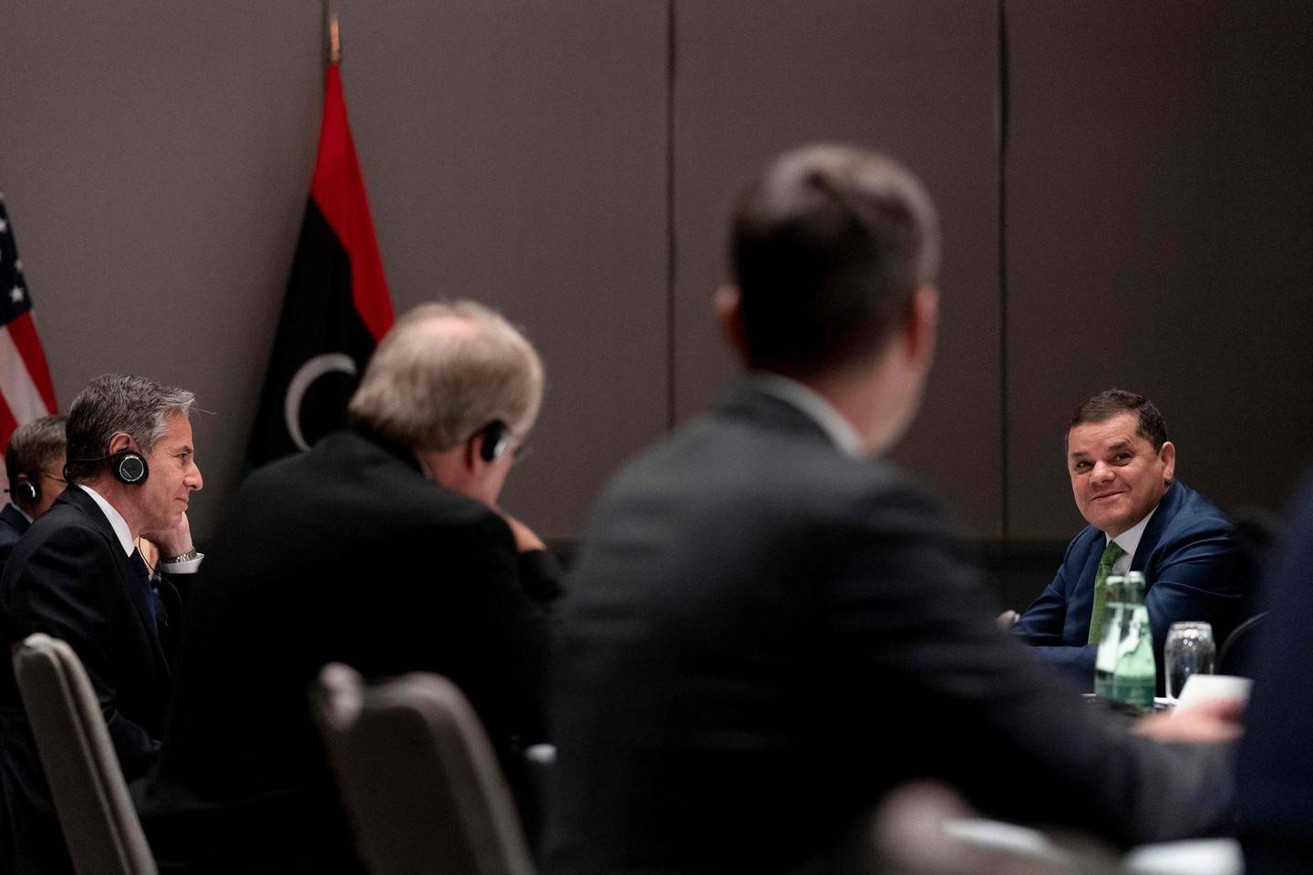 US Secretary of State Antony Blinken (L) attends a meeting with Libyan Prime Minister Abdul Hamid Dbeibeh (R) at the Marriott Hotel in Berlin, Germany, on June 24, 2021.   Hopes grew on June 23 for Libya's stability following a decade of bloodshed as Russia and Turkey reached a tentative plan in talks in Berlin to start withdrawing foreign mercenaries, officials said. A UN-sponsored conference -- the second held in the German capital -- renewed commitments to holding elections on December 24, a watershed for the North African nation where foreign powers have violently jostled for influence. / AFP / POOL / Andrew Harnik