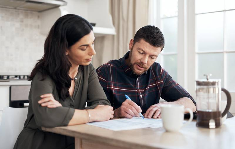 Shot of a young couple going over their finances together at home. Getty Images