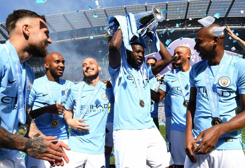 MANCHESTER, ENGLAND - MAY 06:  Yaya Toure of Manchester City celebrates with The Premier League Trophy after the Premier League match between Manchester City and Huddersfield Town at Etihad Stadium on May 6, 2018 in Manchester, England.  (Photo by Michael Regan/Getty Images)