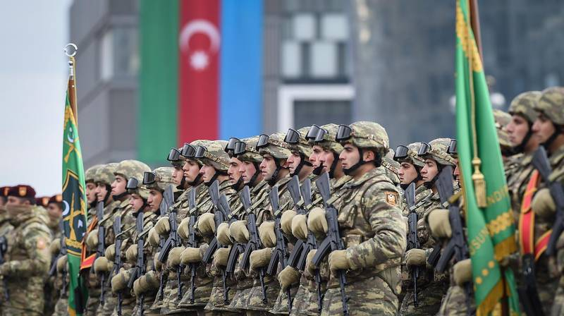 epa08874779 Azerbaijani soldiers during a military parade dedicated to the victory in the Nagorno-Karabakh armed conflict, in Baku, Azerbaijan, 10 December 2020. The simmering territorial conflict between Azerbaijan and Armenia over Nagorno-Karabakh territory erupted into a war between the two countries on 27 September 2020 along the contact line of the self-proclaimed Nagorno-Karabakh Republic (also known as Artsakh). On 09 November 2020 Presidents of Azerbaijan and Russia and Armenian Prime Minister signed a joint statement announcing a complete ceasefire and halt of all military operations in the Nagorno-Karabakh conflict zone, and return of the Aghdam, Kalbajar and Lachin districts to Azerbaijan.  EPA/POMAN ISMAYILOV