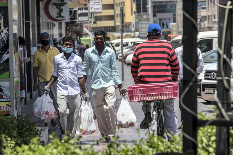 DUBAI, UNITED ARAB EMIRATES. 08 MAY 2020. STANDALONE. People move about in Satwa while the COVID-19 Stay at home measures are in place in the UAE (Photo: Antonie Robertson/The National) Journalist: None Section: National.