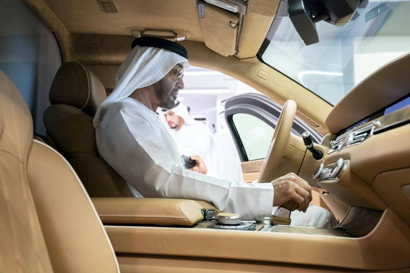 ABU DHABI, UNITED ARAB EMIRATES - February 18, 2019:  HH Sheikh Mohamed bin Zayed Al Nahyan, Crown Prince of Abu Dhabi and Deputy Supreme Commander of the UAE Armed Forces (C) inspects an Aurus vehicle during the 2019 International Defence Exhibition and Conference (IDEX), at Abu Dhabi National Exhibition Centre (ADNEC).  ( Ryan Carter / Ministry of Presidential Affairs ) ---