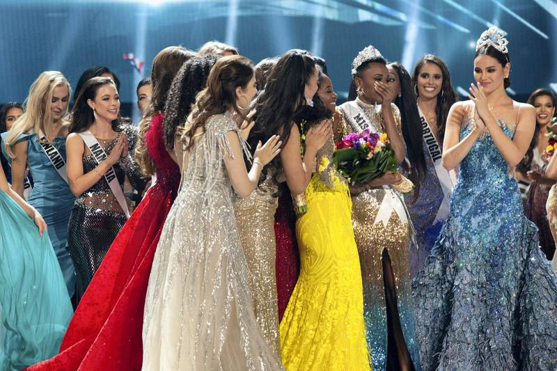 Zozibini Tunzi, Miss South Africa 2019 is congratulated by fellow contestants after being crowned Miss Universe at the conclusion of The MISS UNIVERSE® Competition on FOX at 7:00 PM ET on Sunday, December 8, 2019 live from Tyler Perry Studios in Atlanta. The new winner will move to New York City where she will live during her reign and become a spokesperson for various causes alongside The Miss Universe Organization. HO/The Miss Universe Organization