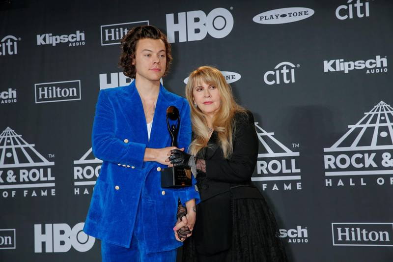 Harry Styles and inductee Stevie Nicks pose for pictures at the press room during the 2019 Rock and Roll Hall of Fame induction ceremony in Brooklyn, New York, U.S., March 29, 2019.  REUTERS/Eduardo Munoz