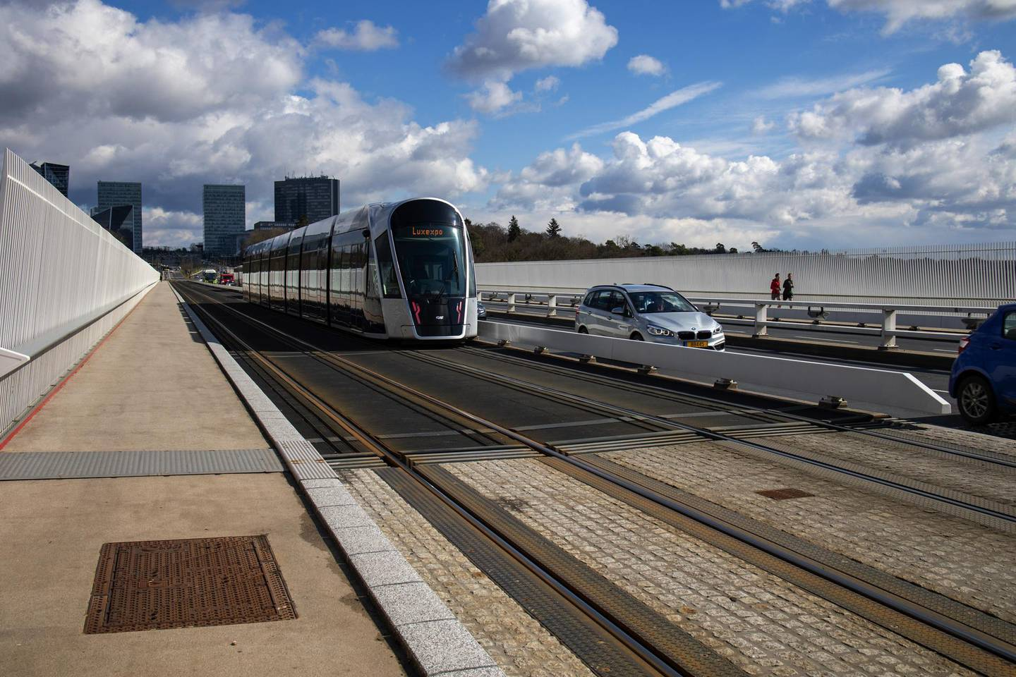 A tram and automobiles travel near skyscrapers in the financial district in Luxembourg, on Monday, March 15, 2021. More than 60 financial firms have established operations in the Grand Duchy due to Brexit, according to Nicolas Mackel, the head of Luxembourg for Finance. Photographer: Olivier Matthys/Bloomberg