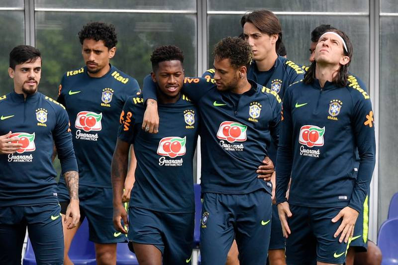 epa06787246 Brazil's Fred (C-L) and Neymar (C-R) embrace during a training session at Tottenham Hotspur's training complex in Enfield, north London, Britain, 05 June 2018. Brazil's national team prepares for the FIFA World Cup 2018 taking place in Russia from 14 June to 15 July 2018.  EPA/WILL OLIVER