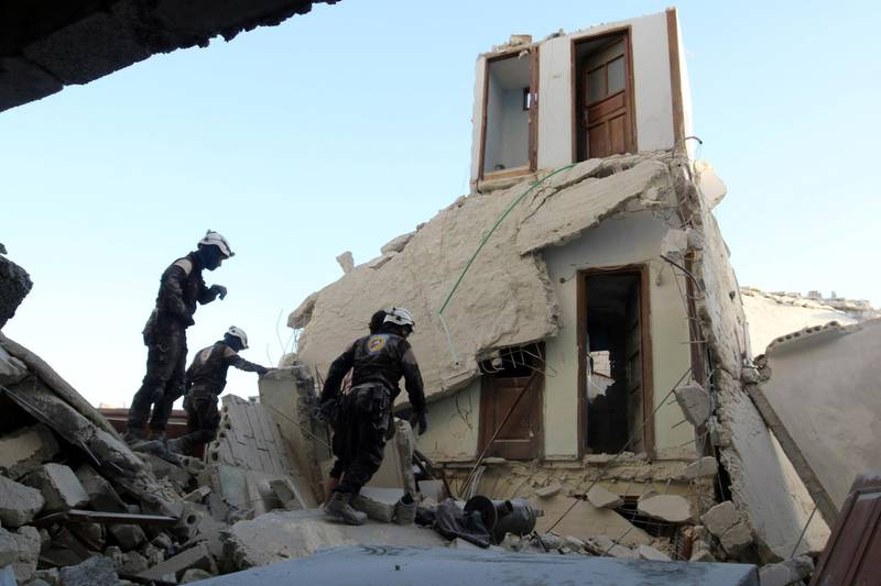 Civil Defence members inspect a damaged site after an airstrike in the besieged rebel-held al-Qaterji neighbourhood of Aleppo, Syria October 14, 2016. REUTERS/Abdalrhman Ismail
