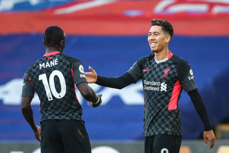 epa08893469 Roberto Firmino (R) of Liverpool celebrates with Sadio Mane (L) after scoring a goal during the English Premier League soccer match between Crystal Palace and Liverpool FC in London, Britain, 19 December 2020.  EPA/Clive Rose / POOL EDITORIAL USE ONLY. No use with unauthorized audio, video, data, fixture lists, club/league logos or 'live' services. Online in-match use limited to 120 images, no video emulation. No use in betting, games or single club/league/player publications.