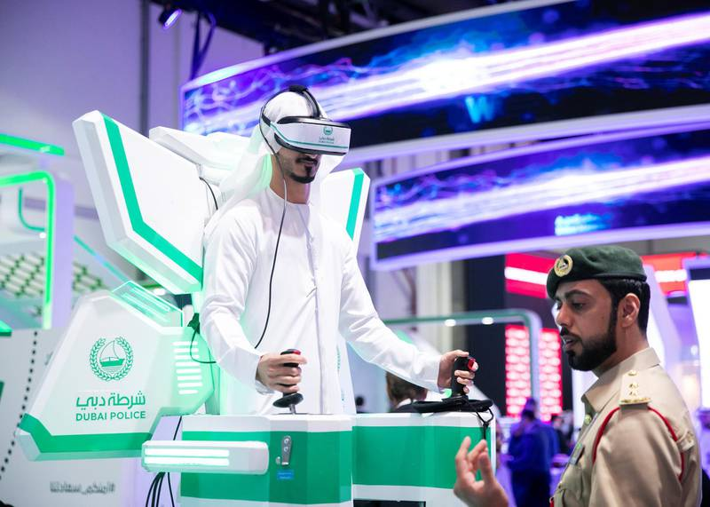 DUBAI, UNITED ARAB EMIRATES. 06 OCTOBER 2019. A man plays a virtual game at Dubai Police's booth during Gitex Technology Week at Dubai World Trade Center.(Photo: Reem Mohammed/The National)Reporter:Section: