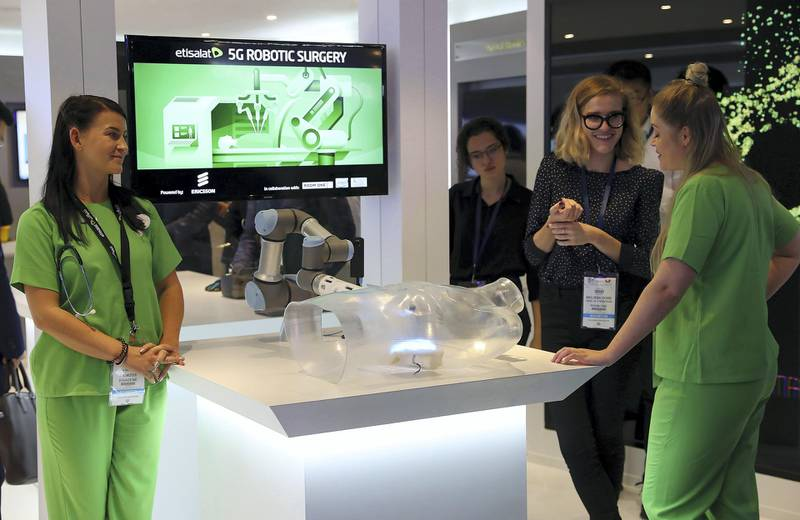 DUBAI , UNITED ARAB EMIRATES , OCT 10   – 2017 :- Visitors looking at the 5G Robotic Surgery which is on display at the Etisalat stand during the GITEX Technology Week held at Dubai World Trade Centre in Dubai. (Pawan Singh / The National ) Story by Nicholas Webster