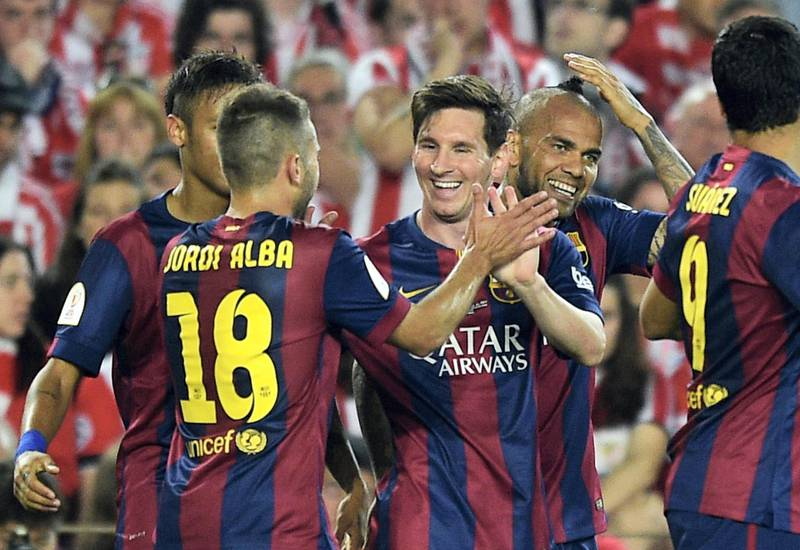 Barcelona's Argentinian forward Lionel Messi (C) celebrates with teammates after scoring during the Spanish Copa del Rey (King's Cup) final football match Athletic Club Bilbao vs FC Barcelona at the Camp Nou stadium in Barcelona on May 30, 2015.   AFP PHOTO/ LLUIS GENE (Photo by LLUIS GENE / AFP)
