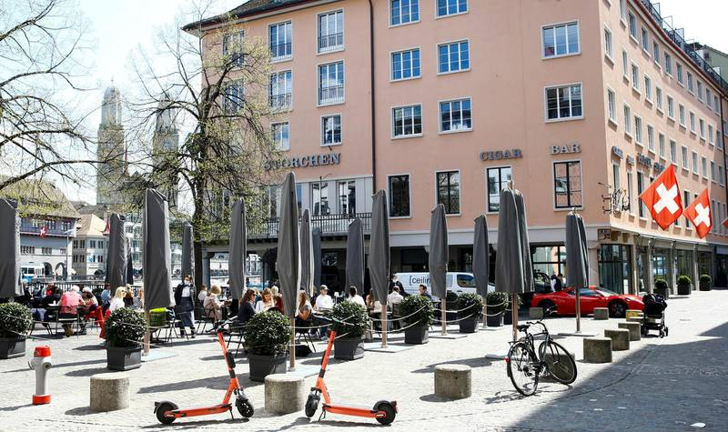 Guests enjoy the sunny weather as they sit in front of Hotel Storchen after the Swiss government allowed to reopen outdoor terraces, as the spread of the coronavirus disease (COVID-19) continues, in Zurich, Switzerland April 20, 2021. REUTERS/Arnd Wiegmann