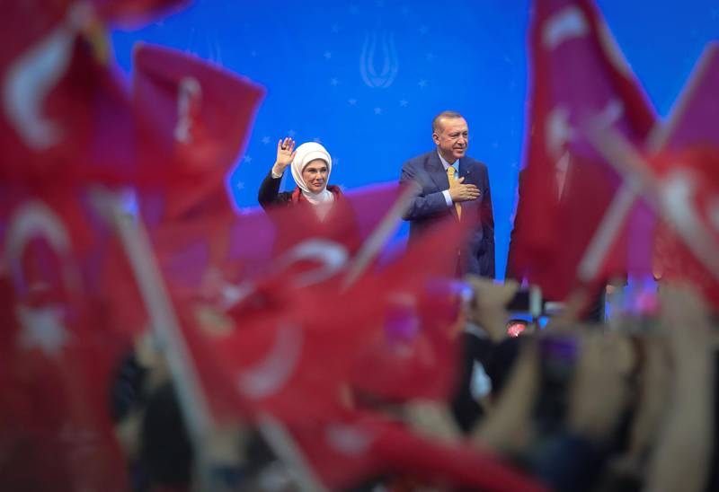 Turkish President Recep Tayyip Erdogan and his wife Emine Erdogan wave during a pre-election rally in Sarajevo, on May 20, 2018.  Recep Tayyip Erdogan holds today the only election rally outside Turkey ahead of the June 24 presidential and parliamentary election. Sarajevo was chosen for the rally after several European Union countries, including Germany, banned such rallies in the campaign for last year's referendum on a new system enhancing the powers of the Turkish presidency.  / AFP / OLIVER BUNIC