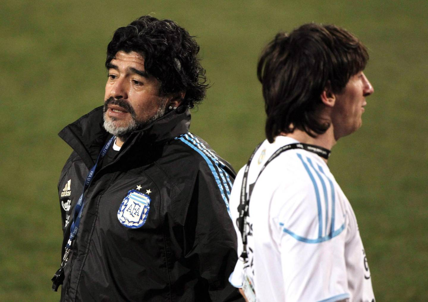 epa08842433 (FILE) - Argentina's head coach Diego Maradona (L) passes by Argentinian forward Lionel Messi (R) during their team's training session at the Pretoria University's specialized sports training centre in Pretoria, South Africa, 30 June 2010 (re-issued on 25 November 2020). Diego Maradona has died after a heart attack, media reports claimed on 25 November 2020. The Argentine soccer great was among the best players ever and who led his country to the 1986 World Cup title before later struggling with cocaine use and obesity. He was 60.  EPA/CEZARO DE LUCA *** Local Caption *** 02231158