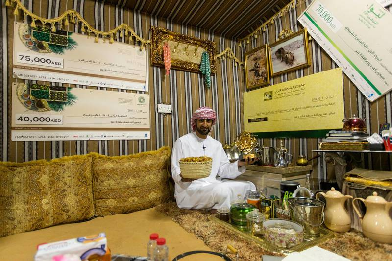 Liwa, United Arab Emirates, July 20, 2017:    Rashed Abdullah, winner of the largest date branch for the Liwa Date Festival in the majalis at his farm in the Al Dhafra Region of Abu Dhabi on July 20, 2017. The festival runs from July 19th to 29th. The winning branch weighed in at 106.5kg. Christopher Pike / The NationalReporter: Anna ZachariasSection: News