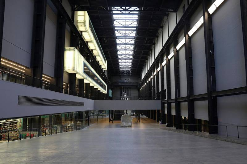 People walk through a sparsely populated Tate Modern as the number of coronavirus cases (COVID-19) grows around the world in London, Britain March 16, 2020. REUTERS/Simon Dawson