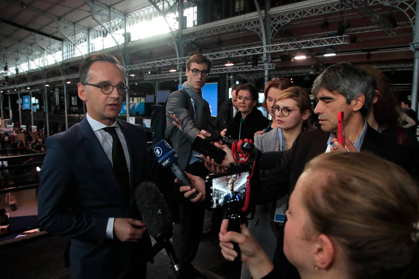 German Foreign Minister Heiko Maas answers reporters as he attends the Paris Peace Forum, Tuesday, Nov. 12, 2019 in Paris. (AP Photo/Michel Euler)